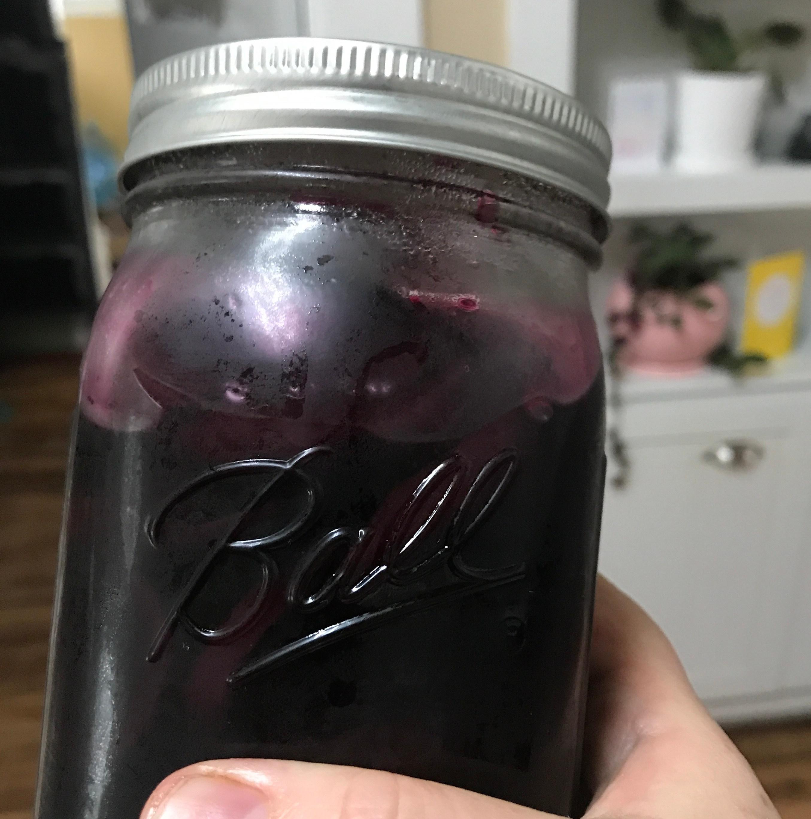 a glass quart jar of purple beets